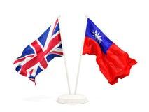 Deux drapeaux de ondulation du R-U et de Ta?wan d'isolement sur le blanc illustration de vecteur