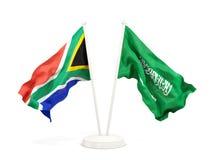 Deux drapeaux de ondulation de l'Afrique du Sud et de l'Arabie Saoudite d'isolement sur le blanc illustration de vecteur