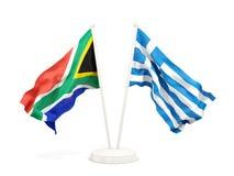 Deux drapeaux de ondulation de l'Afrique du Sud et de la Gr?ce d'isolement sur le blanc illustration libre de droits
