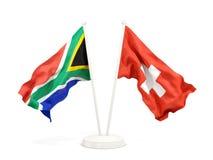 Deux drapeaux de ondulation de l'Afrique du Sud et de la Suisse d'isolement sur le blanc illustration de vecteur