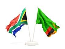 Deux drapeaux de ondulation de l'Afrique du Sud et de la Zambie d'isolement sur le blanc illustration stock