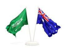 Deux drapeaux de ondulation de l'Arabie Saoudite et de l'australie d'isolement sur le blanc illustration stock