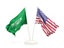 Deux drapeaux de ondulation de l'Arabie Saoudite et des Etats-Unis d'isolement sur le blanc illustration libre de droits