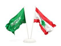 Deux drapeaux de ondulation de l'Arabie Saoudite et du Liban d'isolement sur le blanc illustration stock