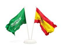Deux drapeaux de ondulation de l'Arabie Saoudite et de l'Espagne d'isolement sur le blanc illustration de vecteur