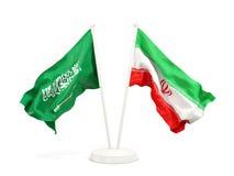 Deux drapeaux de ondulation de l'Arabie Saoudite et de l'Iran d'isolement sur le blanc illustration de vecteur