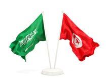 Deux drapeaux de ondulation de l'Arabie Saoudite et de la Tunisie d'isolement sur le blanc illustration stock