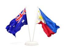 Deux drapeaux de ondulation de l'Australie et des Philippines d'isolement sur le blanc illustration stock