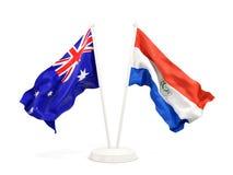 Deux drapeaux de ondulation de l'Australie et du Paraguay d'isolement sur le blanc illustration stock