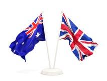 Deux drapeaux de ondulation de l'Australie et du R-U d'isolement sur le blanc illustration de vecteur
