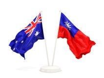 Deux drapeaux de ondulation de l'Australie et du Taiwan d'isolement sur le blanc illustration stock