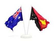 Deux drapeaux de ondulation de l'Australie et de la Papouasie-Nouvelle-Guinée d'isolement sur le blanc illustration stock