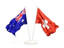 Deux drapeaux de ondulation de l'Australie et de la Suisse d'isolement sur le blanc illustration libre de droits