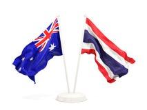 Deux drapeaux de ondulation de l'Australie et de la Thaïlande d'isolement sur le blanc illustration stock