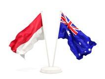 Deux drapeaux de ondulation de l'Indonésie et de l'australie d'isolement sur le blanc illustration de vecteur