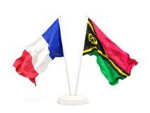 Deux drapeaux de ondulation de la France et du Vanuatu d'isolement sur le blanc illustration de vecteur