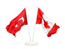 Deux drapeaux de ondulation de la Turquie et du Canada d'isolement sur le blanc illustration de vecteur