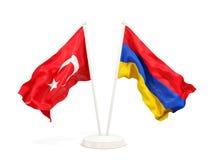 Deux drapeaux de ondulation de la Turquie et de l'Arm?nie d'isolement sur le blanc illustration stock
