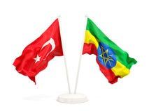 Deux drapeaux de ondulation de la Turquie et de l'Ethiopie d'isolement sur le blanc illustration de vecteur