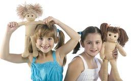 Deux enfants avec leurs poupées préférées Images libres de droits