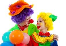 Deux enfants rectifiés en tant que clown drôle coloré photo libre de droits