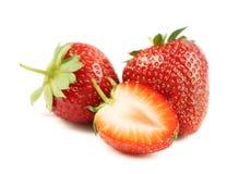 Deux et demi fraises. Photographie stock libre de droits