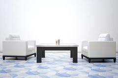Deux fauteuils de cuir blanc Image libre de droits