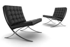 Deux fauteuils noirs d'isolement sur le fond blanc Photos libres de droits
