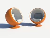Deux fauteuils oranges ronds élégants Photos stock