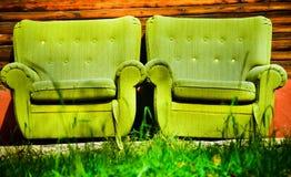 Deux fauteuils verts Photos stock