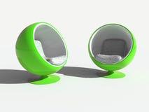 Deux fauteuils verts ronds élégants Photographie stock