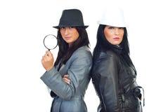Deux femmes de détectives de beauté Photos stock