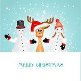 Deux figurines de bonhomme de neige et renne drôle Images stock