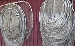 Deux filets de pêche sur le mur Images stock