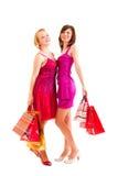 Deux filles après des achats réussis Photographie stock libre de droits