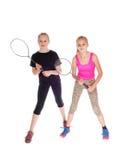 Deux filles avec la raquette de tennis Photographie stock libre de droits