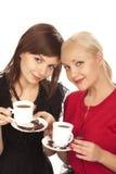 Deux filles buvant du café Images stock