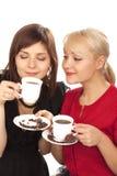 Deux filles buvant du café Photographie stock libre de droits
