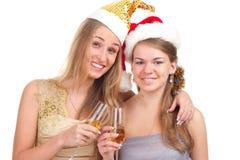 Deux filles célèbrent Noël Photo libre de droits