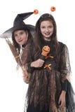 Deux filles dans des costumes de veille de la toussaint Photos stock