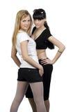 Deux filles dans des vêtements de la jeunesse Photo stock