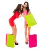 Deux filles de sourire avec des sacs Photographie stock