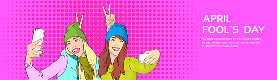 Deux filles prenant à cellule de Selfie le téléphone intelligent, April Fool Day Holiday Banner, art de bruit illustration stock