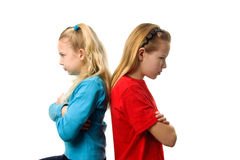 Deux filles sont fâchées contre l'un l'autre Image stock
