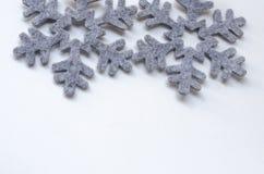 Deux flocons de neige gris de tissu Photographie stock libre de droits