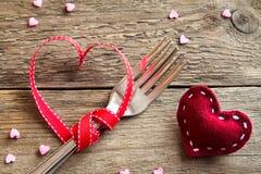Deux fourchettes et coeurs rouges Photo libre de droits