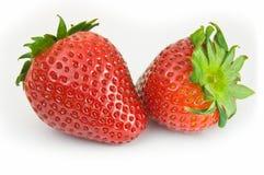 Deux fraises d'isolement images stock