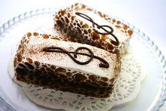 Deux gâteaux avec la clef triple Photographie stock libre de droits