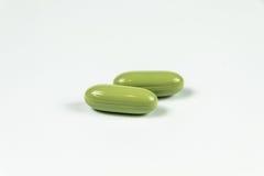 Deux gélules molles vert clair Images stock