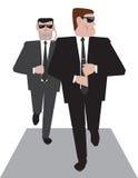 Deux gardes du corps au travail Photo stock